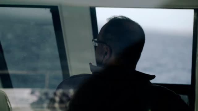 Man driving a yacht video