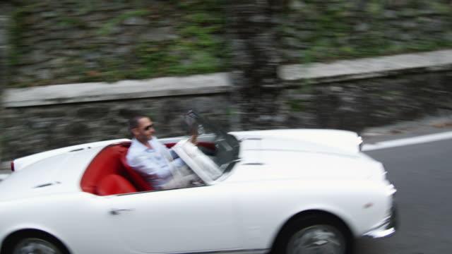 Man driving cabriolet video
