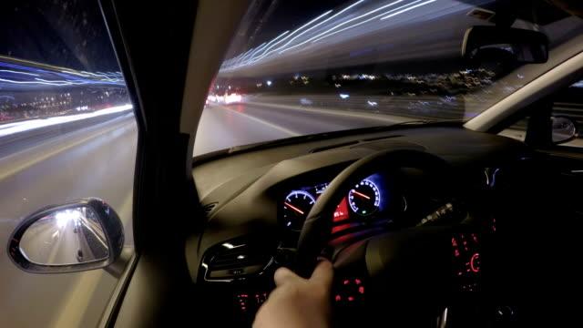 Man driving car at night timelapse video