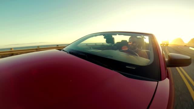 WS POV Man Driving Convertible Along The Coast video