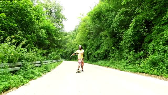 Man driving longboard. Slow motion video