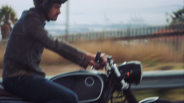 Man driving on his motorcycle through the city video