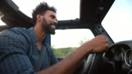 Man Driving Open Top Car On Country Road video