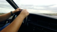 Man driving vintage car on highway video
