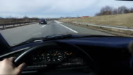 Man driving vintage car very fast on highway, POV video