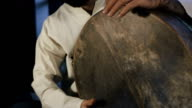 man drumming out a beat on an arabic percussion drum named Bendir at home. video