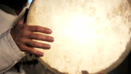 man drumming out a beat on an arabic percussion drum named Dayereh at home. video