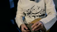 man drumming out a beat on an arabic percussion drum named Tombak at home. video