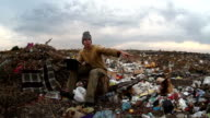 man dump unemployed homeless dirty looking food waste in landfill  social video video