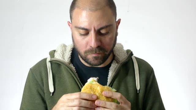 man eating an XXL hamburger: diet, junk food, fast food video