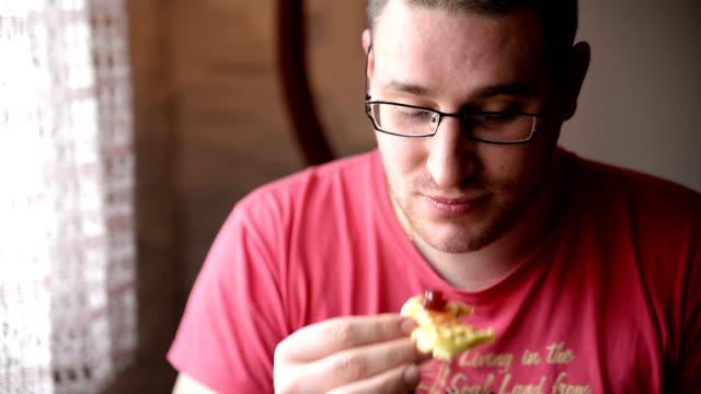 Man eating cookie video