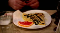 man eating dessert in a restaurant video