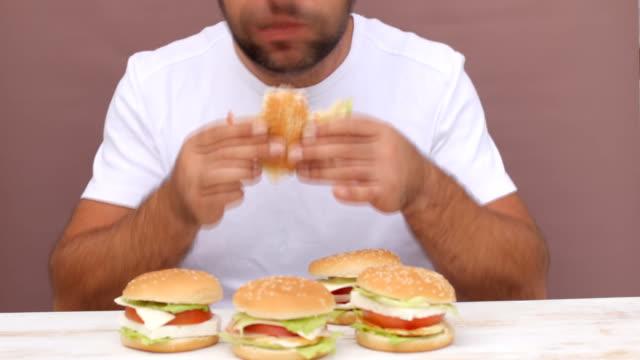 Man eating hamburger, Unhealthy eating, Timelapse video