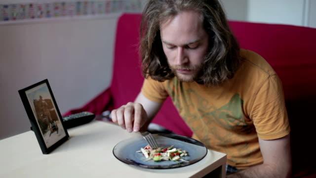 Man eating salad video