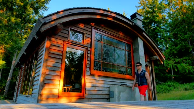 Man Enjoying View from Cabin atop Mountain video