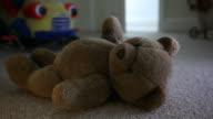 Man entering child's room, teddy bear on the floor. video