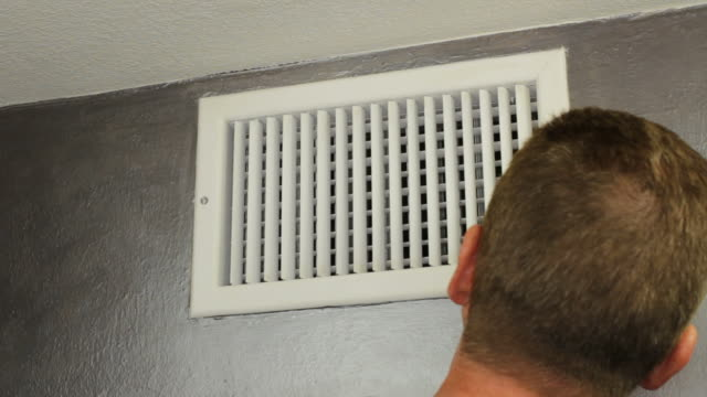 Man Examining an Air Vent video