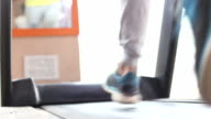 Man exercising on treadmill in a gym video