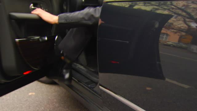 Man Exits Black Car video