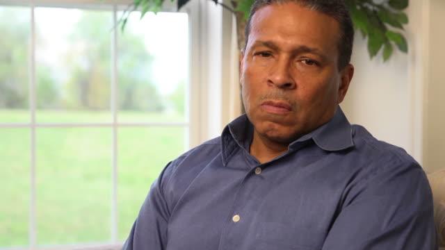 Man Expresses Concern and Sorrow Looking at Camera b video