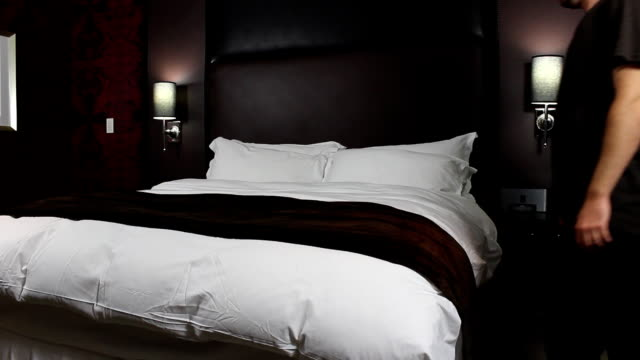 Man falls on bed - HD video