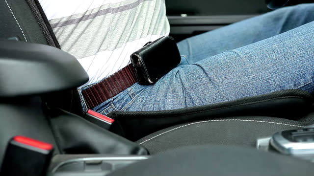 Man fastens his seat belt in the car video