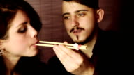 Man feed his girlfriend sushi and smile video