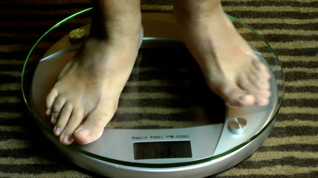 Man feet on a scale video