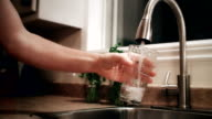 Man Filling a Glass of Water Before to go to Bed video