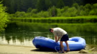 Man fills raft with air video