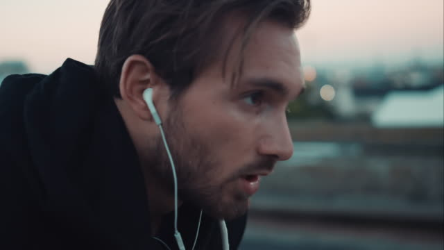 Man finishs jogging in urban setting video