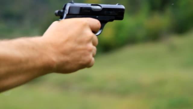 Man firing from a gun to target video