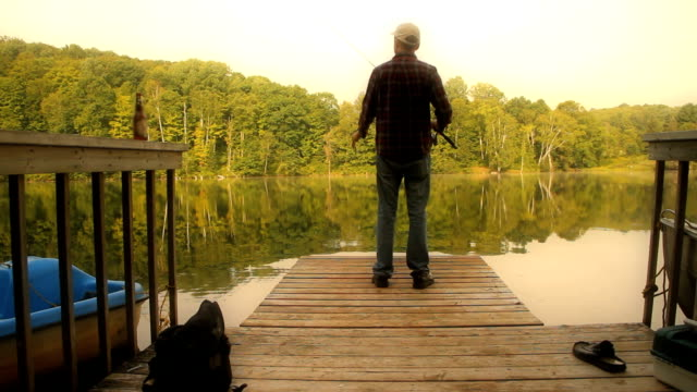 Man Fishing on Dock video