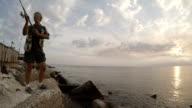 Man fishing. Slow motion video