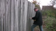 Man fixing a fence video