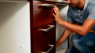 Man fixing the drawer video