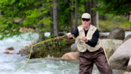 Man fly fishing on a mountain river video