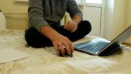 Man focused on work or social media on his laptop video
