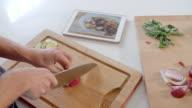 Man Follows Recipe On Digital Tablet In Kitchen Shot On R3D video