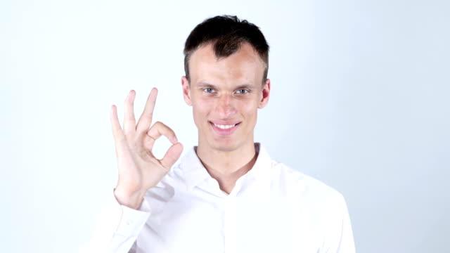 man gesturing OK sign on white background video