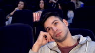 Man gets bored at the movie theater video