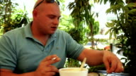Man getting change in cafe video