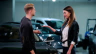 Man give the keys the girl from the car video