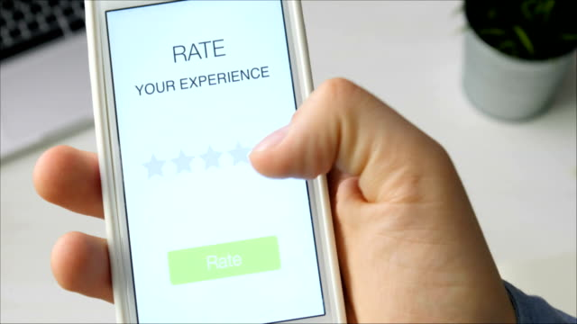Man gives five star rating using smartphone application video