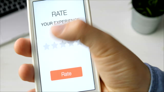 Man gives one star rating using smartphone application video