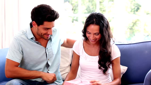 Man giving his girlfriend a pink gift video