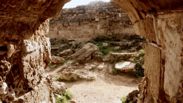 POV man go through old corridor to yard with ruins antique town Salamis east Cyprus Famagusta video