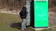 Man go to in green portable toilet video