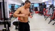 Man goes through gym and prepares for training video