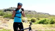 Man going cycling putting helmet on video